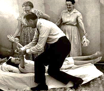 Oral Roberts praying for a bedridden girl